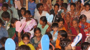 Children Waiting for their new flip flop